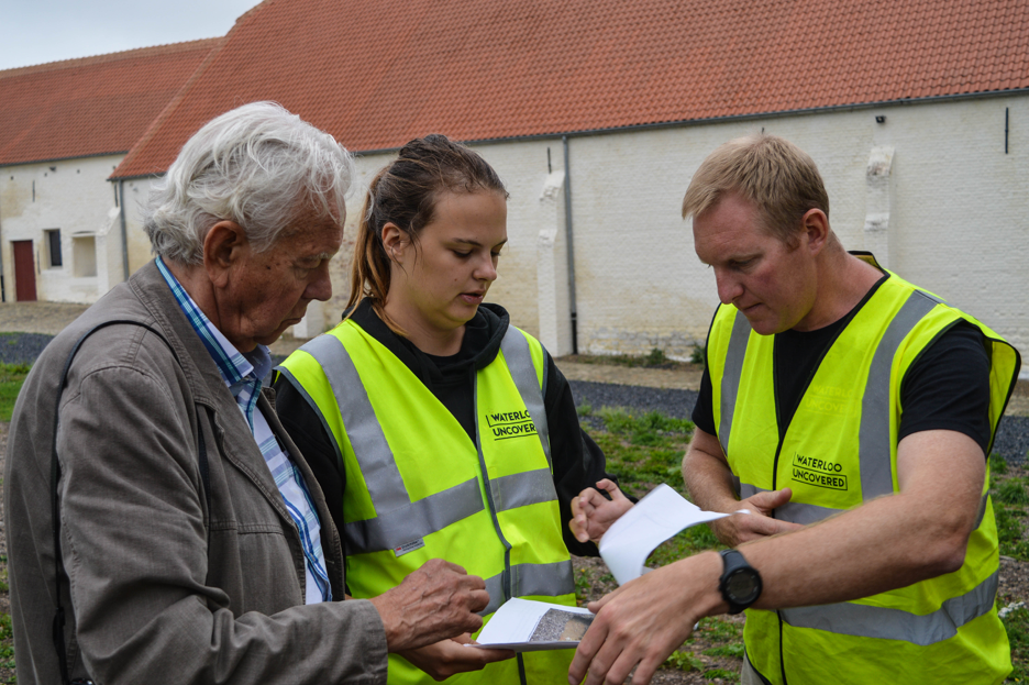 Rob, Charlotte and Charlie going over the excavation data