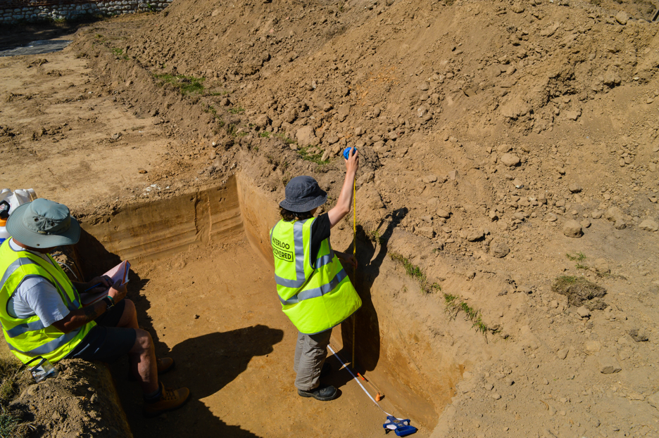 Camille measuring the height of the trench