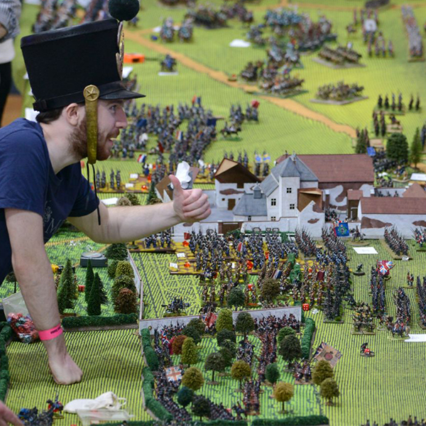 A participant of the Great Game wargaming event in 2019 plays on a large scale board of the Waterloo battlefield
