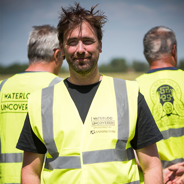 Mark Evans, the CEO of Waterloo Uncovered, on site in Belgium wearing a yellow high vis jacket